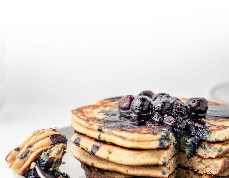 Fluffy blueberry pancakes for breakfast on the white table